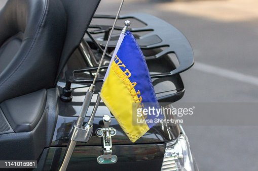 Flag of Ukraine on a motorcycle traveling biker : Stock Photo