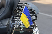 National symbol. Blue-yellow flag of Ukraine. Biker accessory. Patriotic sign on a motorcycle traveler. Ukrainian motorcyclist. Preserved for good luck on a long journey. The inscription Ukraine.