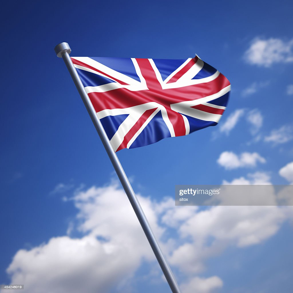 Flag of United Kingdom, the - against blue sky : Stock Photo