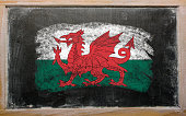 Chalky welsh flag painted with color chalk on old blackboard
