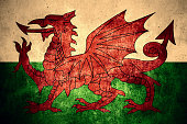 flag of Wales or Welsh banner on rough pattern texture vintage background