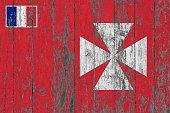 Flag of Wallis And Futuna painted on worn out wooden texture background.