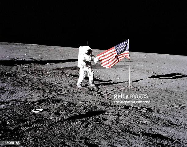 US Flag On The Moon Apollo 12 Astronaut Charles 'Pete' Conrad Stands Beside The US Flag After It Was Unfurled On The Lunar Surface On Nov 1969...