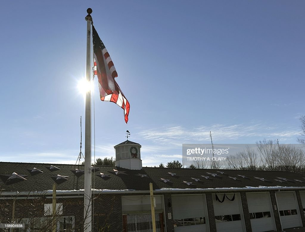 A flag outside the Sandy Hook Fire department in Newtown, Connecticut on January 3, 2013. Students at the elementary school where a gunman massacred 26 children and teachers last month were returning Thursday to classes at an alternative campus described by police as 'the safest school in America.' Survivors were finally to start their new academic year in the nearby town of Monroe, where a disused middle school has been converted and renamed from its original Chalk Hill to Sandy Hook. AFP PHOTO / TIMOTHY A. CLARY