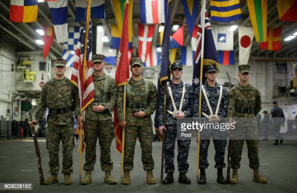 A flag party of US Marines and Navy personnel take part in a ceremony marking the start of Talisman Saber 2017 a biennial joint military exercise...