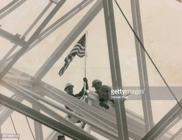Flag Planted Atop Last Piece of Steel Foreman Don Stice left of 1675 S Vrain St and Ralph Walker 8361 Shoshone St Adams County put flag Tuesday on...