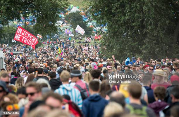 A flag reading 'In Jeremy we trust' is seen amongst crowds near the Pyramid stage after watching Labour Party leader Jeremy Corbyn speak at...