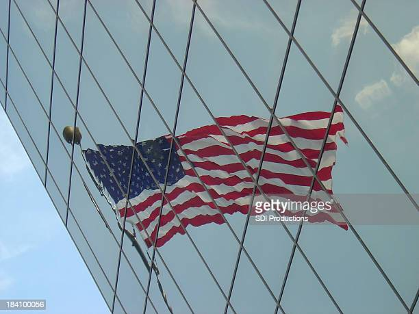 Flag Reflecting in an angled office building