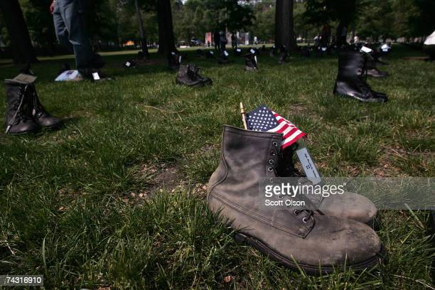 A flag rests in a pair of military boots placed as a memorial to one of the nearly 3500 servicemen killed in Iraq May 24 2007 in Chicago Illinois The...
