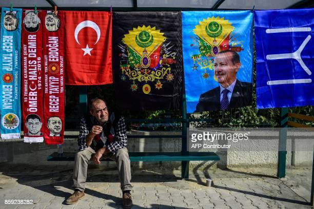 A flag seller sits on a bench as he waits for customers by the Silivri prison courthouse in Istanbul on October 9 during a trial of 143 soldiers...