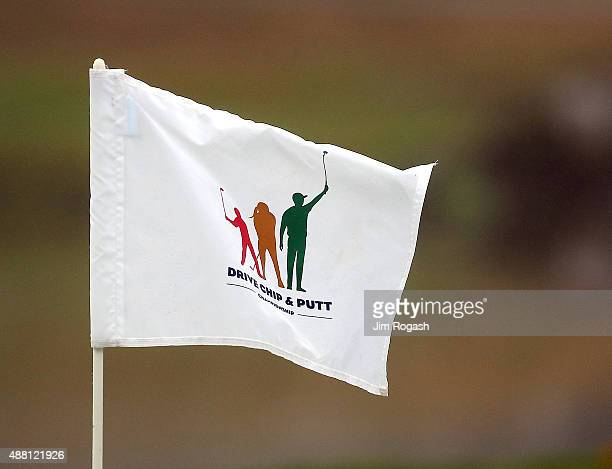 A flag sits atop a pin during the Drive Chip and Putt Championship at The Country Club on September 13 2015 in Brookline Massachusetts