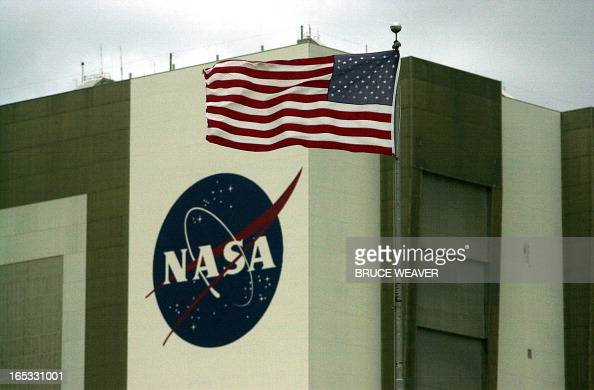 A flag stands out as winds over 20 mph buffet Kennedy Space Center 09 October 2000 to causing NASA managers delay the launch of the Space Shuttle...