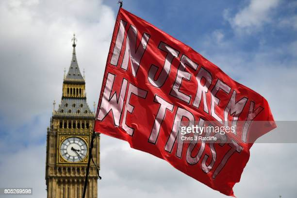 A flag supporting Labour Party leader Jeremy Corbyn flies with Big Ben in the background during the 'Not One Day More' march at Parliament Square on...