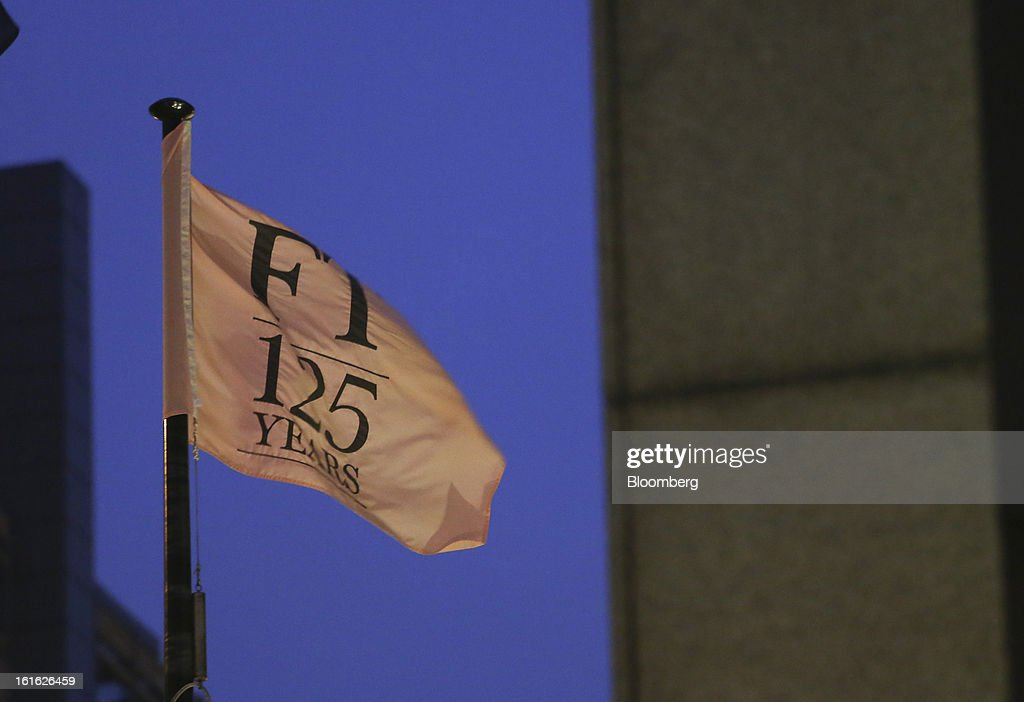 A flag that reads 'FT 125 Years' flies at the headquarters of the Financial Times newspaper as part of their 125th anniversary celebrations, in London, U.K. on Wednesday, Feb. 13, 2013. Pearson Plc, owner of the Financial Times newspaper, cut its forecast for 2012 and predicted a difficult 2013, as tougher market conditions hit earnings at its professional education and FT Group units. Photographer: Chris Ratcliffe/Bloomberg via Getty Images