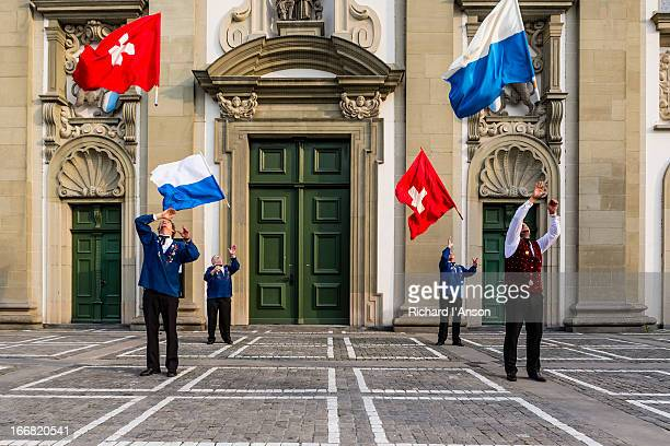 Flag throwers performing outside Jesuit Church