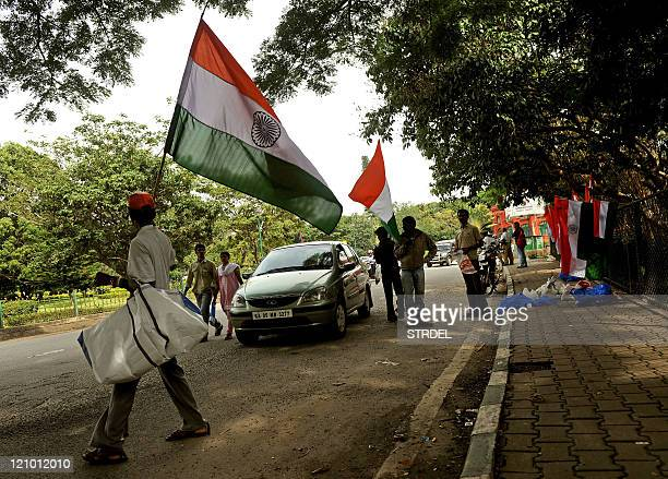 Flag vendors sell the Indian tricolour national flag to commuters driving past in Bangalore on August 13 2011 Ahead of the 64th Independence Day...
