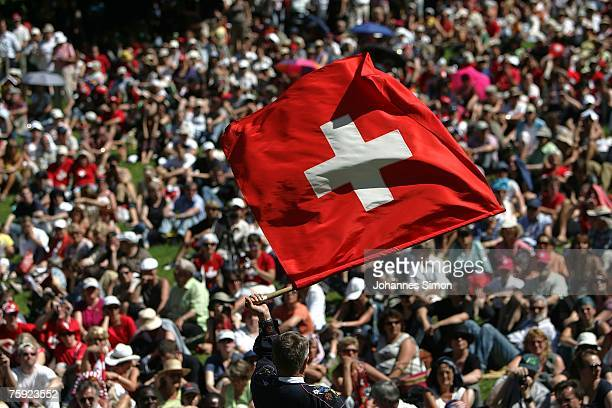 A flag waver brandishes a Swiss flag during the Ruetli celebrations on August 1 near Luzern Switzerland Every year the reenactment of the forming of...
