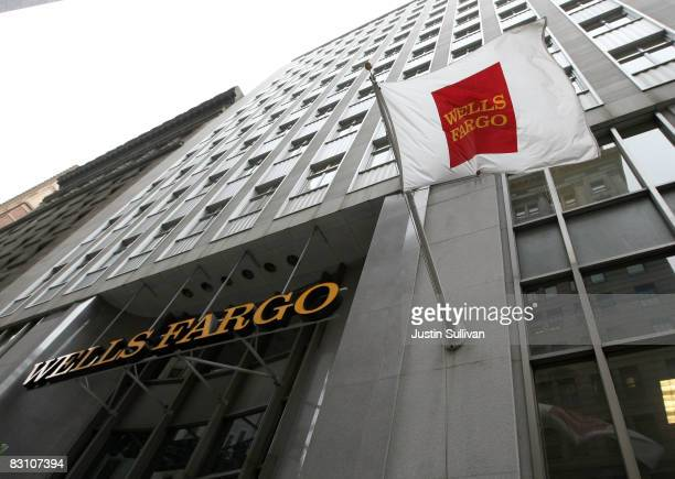 A flag waves outside of a Wells Fargo bank branch October 3 2008 in San Francisco California Four days after Citigroup had announced that it was...