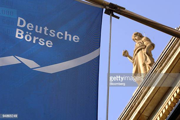 A flag waves outside the German stock exchange in Frankfurt Germany Wednesday October 12 2005 German stocks dropped paced by Schering AG after the...