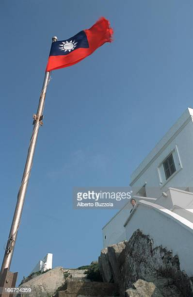 C flag waving at TungYung light house
