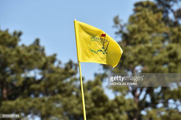 A flag with Masters logo is pictured during Round 3 of the 80th Masters Golf Tournament at the Augusta National Golf Club on April 9 in Augusta...
