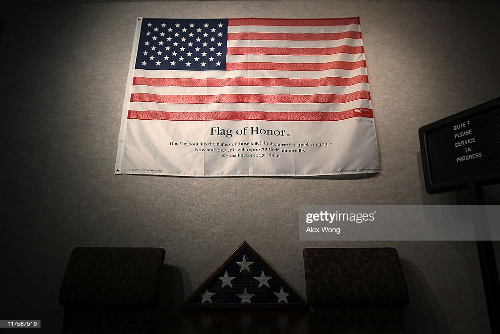 A flag with names of all 184 victims in the Pentagon attack hangs on a wall at the Memorial Chapel of the Pentagon June 28, 2011 in Arlington, Virginia. This year is the 10th anniversary of the September 11 terrorist attacks, in which 184 people were killed at the Pentagon.