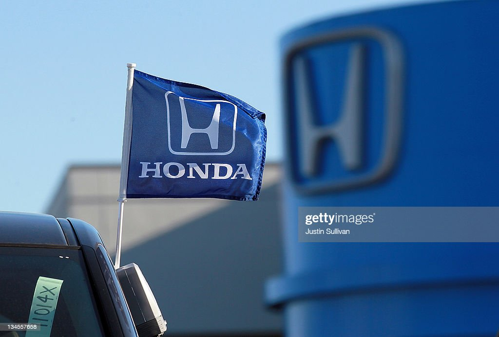 A flag with the Honda logo is displayed on brand new Honda car at Marin Honda on December 2, 2011 in San Rafael, California. Honda Motor Co. announced today that they are recalling 304,000 vehicles around the globe for a possible airbag malfunction in Accord, Civic, Odyssey, Pilot, CR-V and other models that were manufactured between 2001 and 2002.