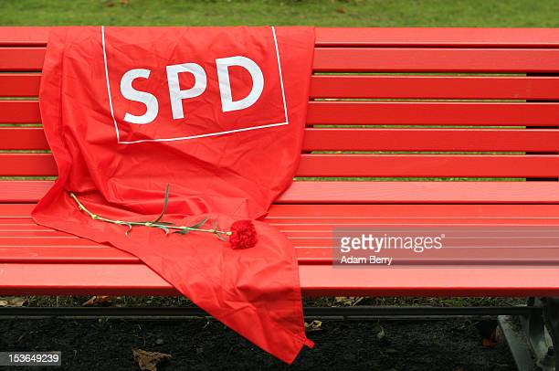 A flag with the logo of the German Social Democrats and a rose lay on a bench near the grave of Willy Brandt former chancellor of the Federal...