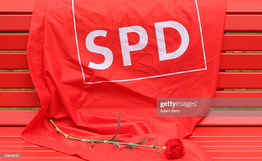 A flag with the logo of the German Social Democrats (SPD) and a rose lay on a bench near the grave of Willy Brandt, former chancellor of the Federal Republic of Germany and Nobel Peace Prize winner, on October 8, 2012 in Berlin, Germany. Brandt was born on December 18, 1913 in Luebeck and died 20 years ago today. He led the SPD from 1964 to 1987 and was chancellor of West Germany from 1969 to 1974, a post from which he resigned after it was revealed that one of his closest aides worked as an agent of the East German secret service, or Stasi. For his efforts to achieve reconciliation between West Germany and the countries of the Soviet bloc, Brandt won the Nobel Prize for Peace in 1971.
