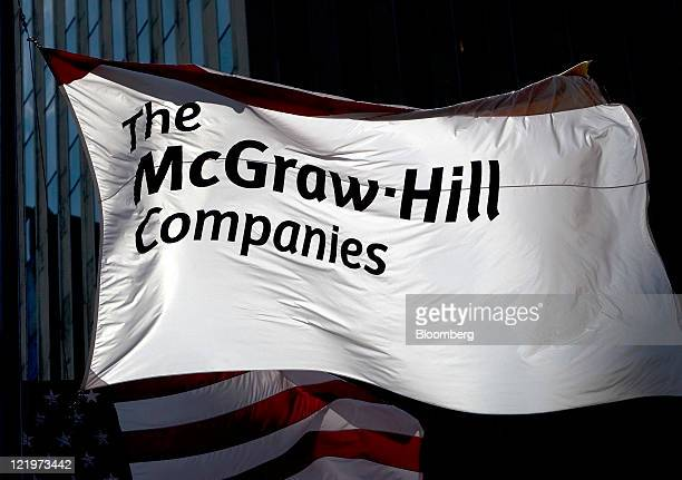A flag with the McGrawHill Cos logo flies in front of the company's headquarters in New York US on Wednesday Aug 24 2011 McGrawHill Cos which does...
