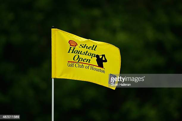 A flag with the Shell Houston Open Logo flaps in the wind on a green during the proam prior to the start of the Shell Houston Open at the Golf Club...