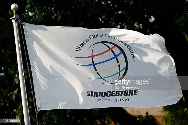 A flag with the tournament logo is seen during the first round of the World Golf Championships Bridgestone Invitational on the South Course at...