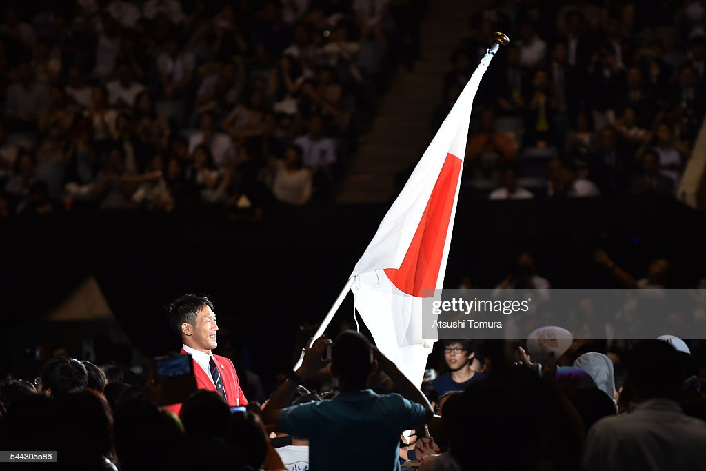 flagbearer-keisuke-ushiro-of-japan-attends-the-sendoff-event-for-the-picture-id544305586