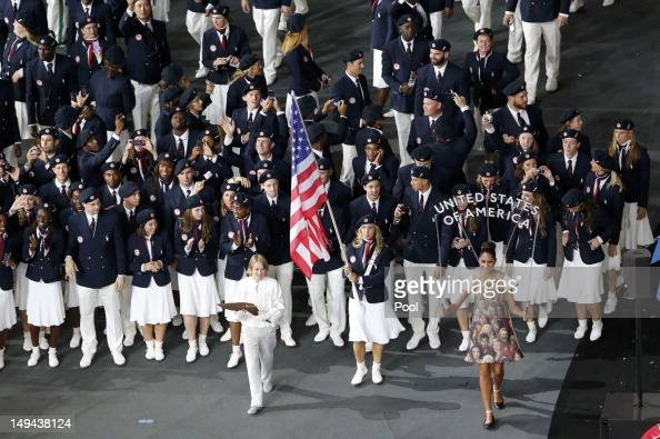 Flagbearer Mariel Zagunis of the US holds the national flag as he leads the contingent in the athletes parade during the opening ceremony of the...