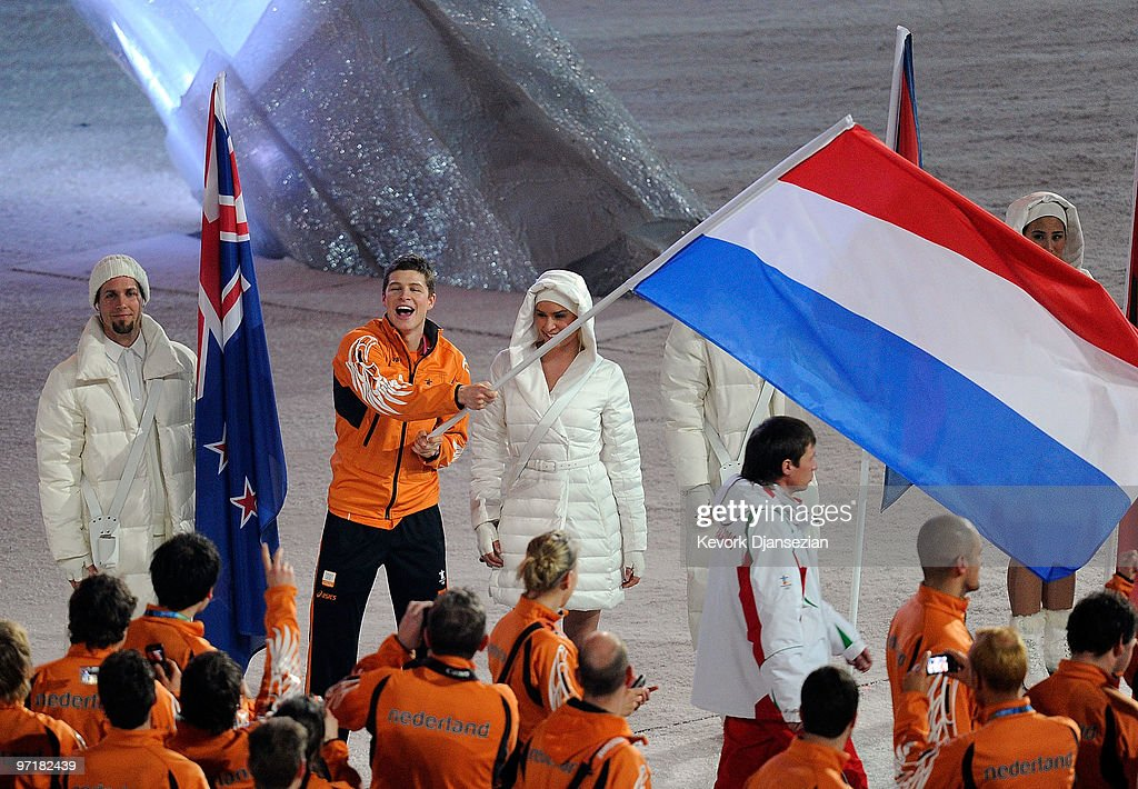 Flagbearer <a gi-track='captionPersonalityLinkClicked' href=/galleries/search?phrase=Sven+Kramer&family=editorial&specificpeople=769363 ng-click='$event.stopPropagation()'>Sven Kramer</a> of Netherlands leads his team during the Closing Ceremony of the Vancouver 2010 Winter Olympics at BC Place on February 28, 2010 in Vancouver, Canada.