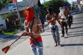 Flagellants whip their backs with wooden flails during holy week on March 28 2013 in Pampanga province Philippines Flagellation is an extreme act of...