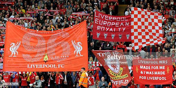 Flags and banners wave in the Kop of Liverpool before the Barclays Premier League match between Liverpool and Everton at Anfield on September 27 2014...