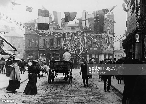 Flags and bunting decorate the marketplace in Sheffield circa 1905