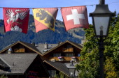 Flags and houses are pictured in the Alpine resort of Gstaad in the canton of Bern on September 20 2012 The canton of Bern is set to vote on...