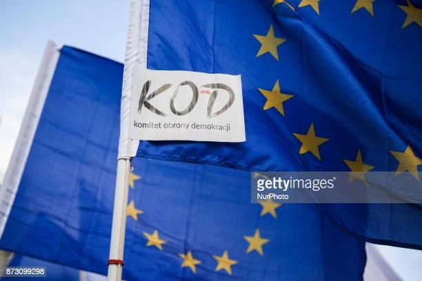 UE flags and KOD logo during the celebration of the Polish Independence Day organised by KOD Krakow Poland on 11 November 2017