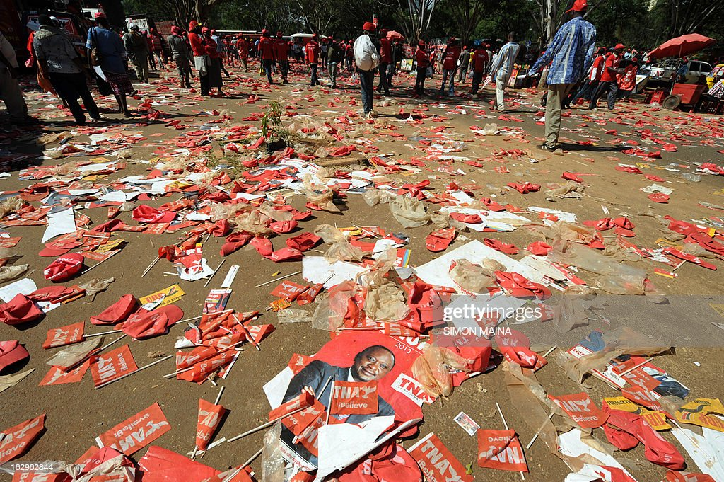 Flags and posters lie on the ground during a rally by Kenya's Deputy Prime Minister and The National Alliance (TNA) presidential candidate Uhuru Kenyatta on March 2, 2013 in Nairobi on the last day of campaigning, 48 hours ahead of presidential, gubernatorial and senatorial elections. AFP PHOTO/SIMON MAINA
