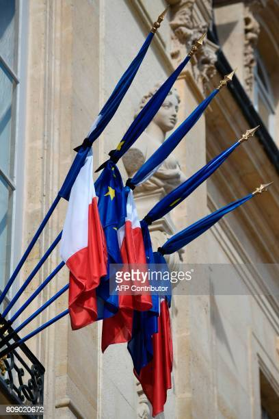 Flags are at half mast on the day of a national tribute to late French politician Simone Veil on July 4 at the Elysee presidential palace in Paris...