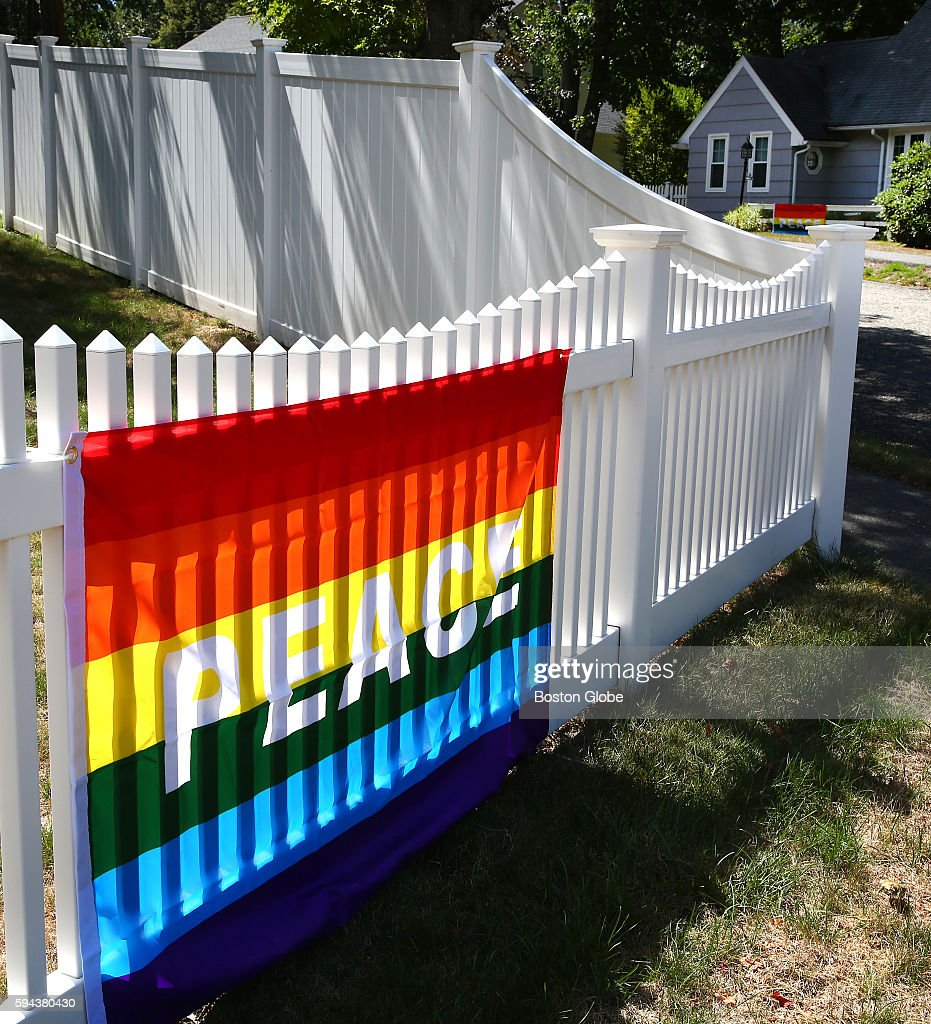 Flags are hung in support of married couple Lauri Ryding and Cari Ryding in a neighborhood on Natick Mass on Aug 22 after the Rydings returned home...