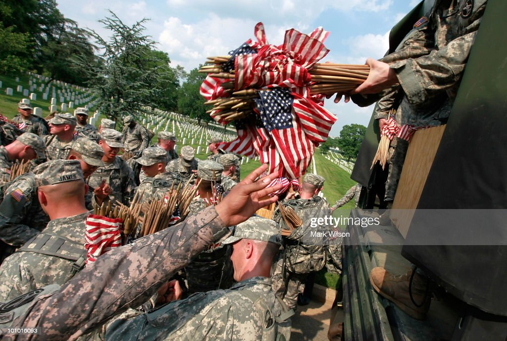 U.S. Flags Are Placed At Graves At Arlington National Cemetery