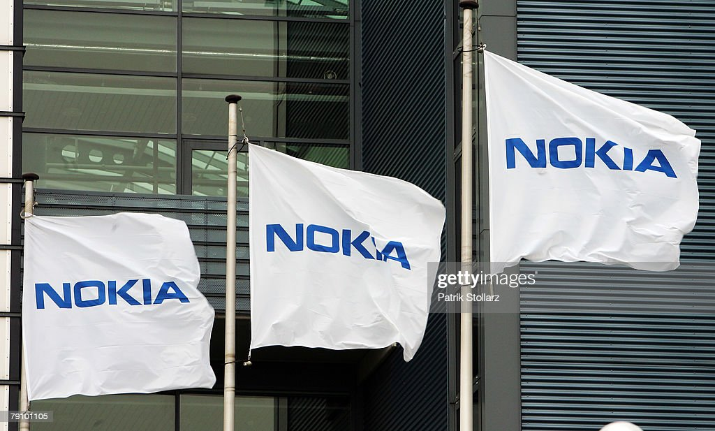 Flags are pictured in front of Finland's mobile phone manufacturer Nokia company's plant on January 18, 2008 in Bochum, Germany. A confederation of German unions warned that the decision by Nokia to close its plant in Bochum threatened the region's economic future.