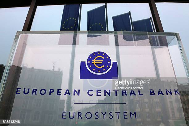 Flags are reflected in the front of the ECB building on December 8 2016 in Frankfurt Germany The ECB today announced that it would continue its...