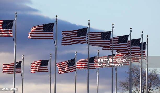 US flags are seen as Prolife supporters gather at the Washington Monument to hear Vice President Mike Pence speak at the March for Life rally on...