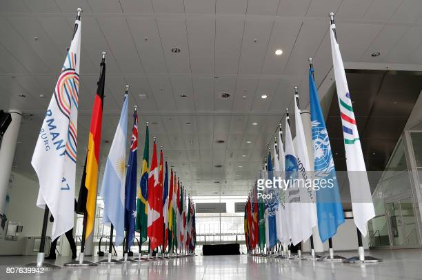 Flags are seen at the fair halls of the G20 summit site on July 4 2017 in Hamburg northern Germany The 2017 G20 Hamburg summit takes place on 07 and...