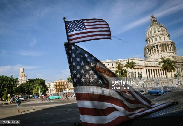 US flags are seen in a bicitaxi near the capitol in Havana on January 23 2015 Hours into historic USCuba talks in Havana a Cuban official came out to...