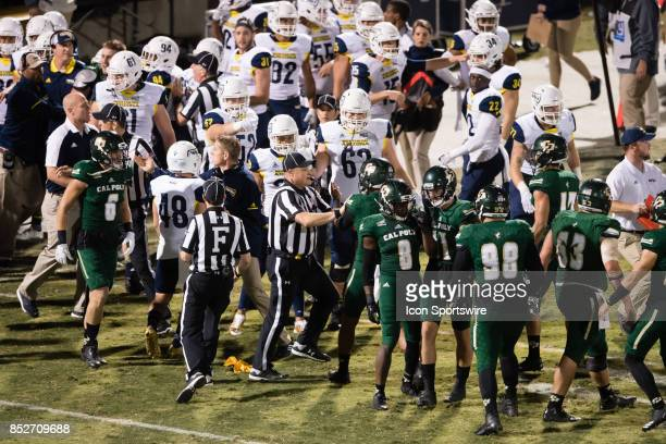 flags are thrown out as the Cal Poly Mustangs and the Northern Arizona Lumberjacks get into a scuffle on the sideline during the game between the...
